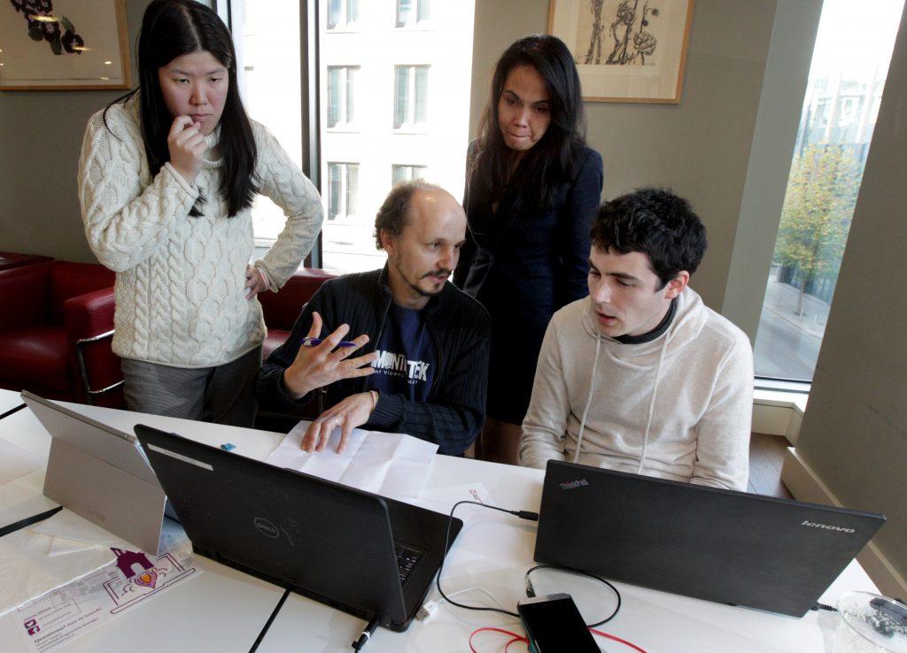 Hackathon participants solving challenges